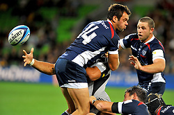 Victor Vito (HUR) blindly offloads.Melbourne Rebels v The Hurricanes.Rugby Union - 2011 Super Rugby.AAMI Park, Melbourne VIC Australia.Friday, 25 March 2011.© Sport the library / Jeff Crow
