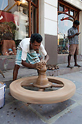 India, pondicherry, Potter works on a potter's wheel