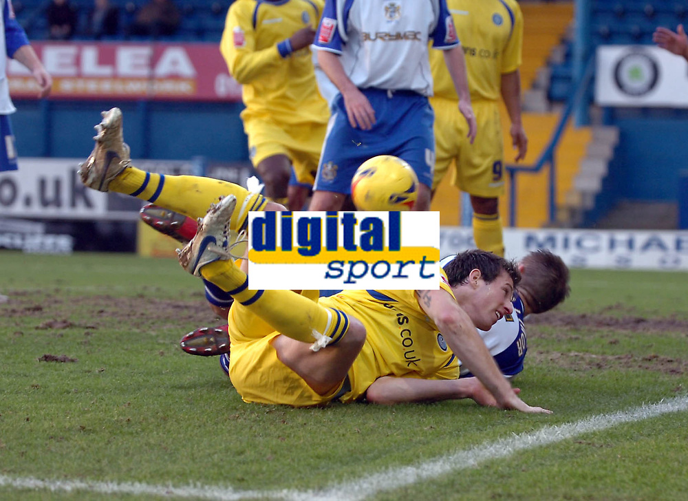 Photo: Paul Greenwood.<br />Bury FC v Wycombe Wanderers. Coca Cola League 2. 17/02/2007. Wycombe's Mike Wilkinson, goes down in the area after the aerial challenge of Bury's Dave Challinor