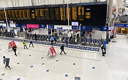 © Licensed to London News Pictures. 23/10/2020. London, UK. A quiet Waterloo Station at the start of the half term holiday. Normally, the station would be busy with travellers. However, due toLondon being in COVID-19 tier two restrictions, and local and regional areas in tier three, commuters are travelling less as the government has imposed tougher measures to manage increasing cases. Photo credit: Dinendra Haria/LNP