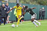 Jake Jervis (10) of AFC Wimbledon on the attack with Ashley Smith-Brown (23) of Plymouth Argyle chasing him during the EFL Sky Bet League 1 match between Plymouth Argyle and AFC Wimbledon at Home Park, Plymouth, England on 6 October 2018.