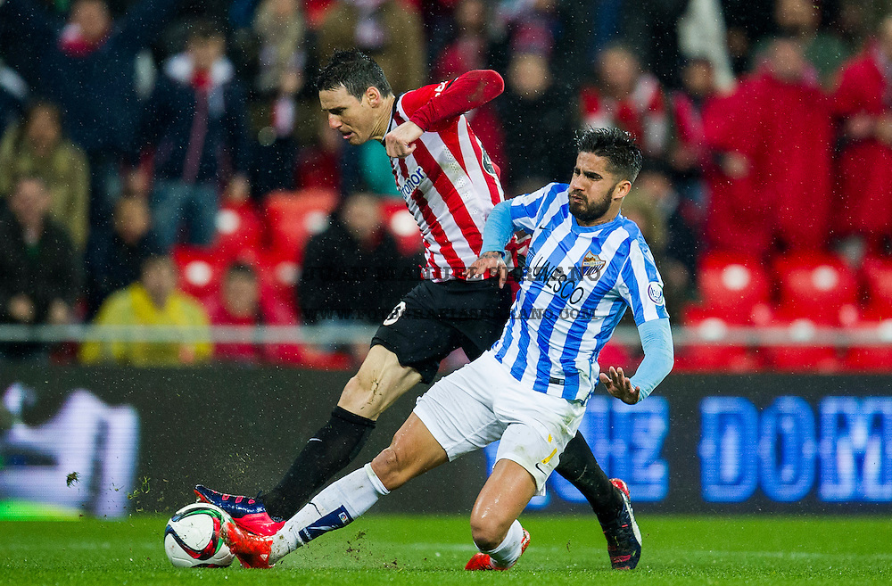 BILBAO, SPAIN - JANUARY 29:  Aritz Aduriz  of Athletic Club duels for the ball with Samuel GarciaÊof Malaga CF during the Copa del Rey Quarter Final Second Leg match between Athletic Club and Malaga CF at San Mames Stadium on January 29, 2015 in Bilbao, Spain.  (Photo by Juan Manuel Serrano Arce/Getty Images)
