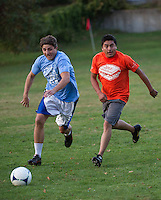 Danny Ringelstein and Nicolas Cruz go for the ball during the annual USA/Mexico soccer matchup to kick off the Sandwich Fair weekend at Quimby Field.  (Karen Bobotas/for the Laconia Daily Sun)