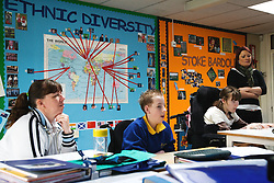 Physically disabled children in a geography lesson,