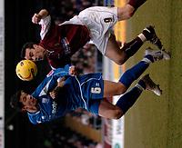 Photo: Ian Hebden.<br />Northampton Town v Rushden & Diamonds. Coca Cola League 2. 04/02/2006.<br />Rushden's Chris Doig (L) beats Northampton's Scott McGleish (R) to the ball.