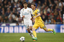 (l-r) Marco Asensio of Real Madrid, Stephan Lichtsteiner of Juventus FC during the UEFA Champions League quarter final match between Real Madrid and Juventus FC at the Santiago Bernabeu stadium on April 11, 2018 in Madrid, Spain