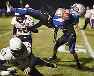 Valley Central wide receiver Nick Pacheco flies into the end zone to score a touchdown against Warwick during a game in Montgomery on Friday, Oct. 25, 2013.