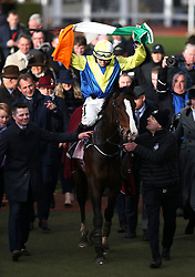 Jockey James Joseph Slevin with horse Band of Outlaws after victory at the Boodles Juvenile Handicap Hurdle during Ladies Day of the 2019 Cheltenham Festival at Cheltenham Racecourse.