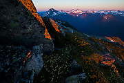 Moonrise at sunset over Spider Mountain and Mount Formidable, seen from Hidden Lake Peaks, North Cascades National Park, Washington.