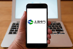 Using iPhone smartphone to display logo of Shanghai Electric power company