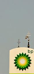 20.07.2010, Ungargasse Wiener Neustadt, Wiener Neustadt, AUT, BP Feature Ölkrise, im Bild BP Logo Kirche mit Kreuz im Hintergrund, EXPA Pictures 2010, PhotoCredit: EXPA/S. Trimmel / SPORTIDA PHOTO AGENCY