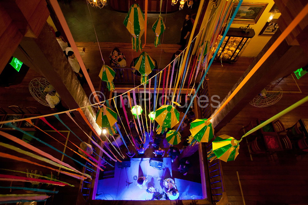 Rio Scenarium is possibly the most famous Samba Bar in Rio de Janeiro. Sitauted in the central and bohemian district of Lapa and spread over three floors, it plays host to some of the best Samba musicians in the World. Here showing the quirky decor and random items on the walls.