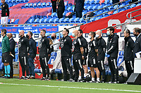 Football - 2020 / 2021 UEFA Nations League - Group B4 - Wales vs Bulgaria<br />      <br /> Wales manager Ryan Giggs  & his bench during the anthems <br /> in a match played with no crowd due to Covid 19 coronavirus emergency regulations, in an almost empty ground, at the Cardiff City Stadium.<br /> <br /> COLORSPORT/WINSTON BYNORTH