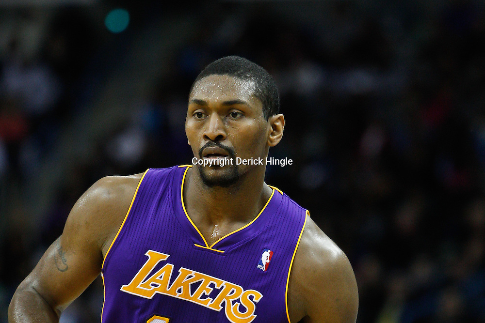 February 5, 2011; New Orleans, LA, USA; Los Angeles Lakers small forward Ron Artest (15) against the New Orleans Hornets during the third quarter at the New Orleans Arena. The Lakers defeated the Hornets 101-95.  Mandatory Credit: Derick E. Hingle