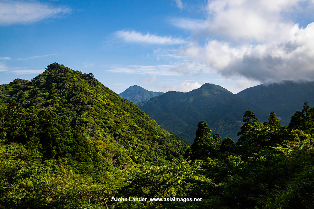 Yakushima is a subtropical island south of Kyushu covered by huge cedar forests that contains some of Japan's oldest living trees some of which are thousands of years old.  Today the forests have recovered past logging days and now enjoys the protection of being  a national park, while other areas are World Heritage Sites.  Most visitors come here to hike through the forests and see the ancient cedar trees.  As a subtropical island Yakushima attracts a lot of rainfall around the year with some rain almost daily especially in the mountainous interior.