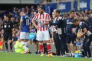 Erik Pieters of Stoke City receives instructions while he takes a drink. Premier league match, Everton v Stoke city at Goodison Park in Liverpool, Merseyside on Saturday 27th August 2016.<br /> pic by Chris Stading, Andrew Orchard sports photography.