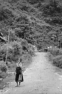 a woman walks along the path to Hon Village, between Sapa and Binh Lu, Vietnam.(Ethnic minority Lu)