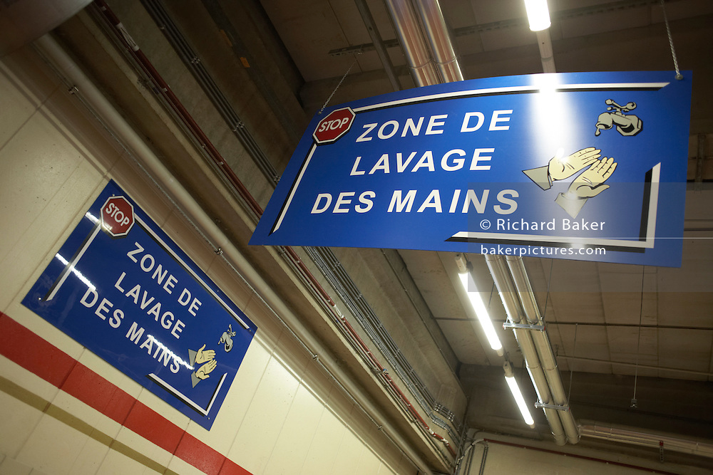 Hygiene sign telling workers where to wash their hands in the United Biscuits-owned Delacre production factory in Lambermont