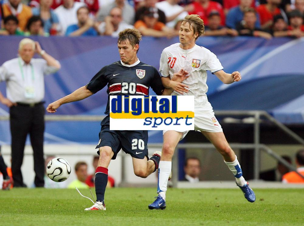 Photo: Chris Ratcliffe.<br /> USA v Czech Republic. Group E, FIFA World Cup 2006. 12/06/2006.<br /> Jaroslav Plasil of Czech Republic clashes with Brian McBride of the USA.