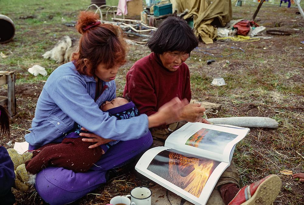 Olga Tinachvanau and daughter looking at Pat O'Hara's book, Chukchi reindeer camp, Senyavina Strait, Chukotsk Peninsula, NE Russia, 1992