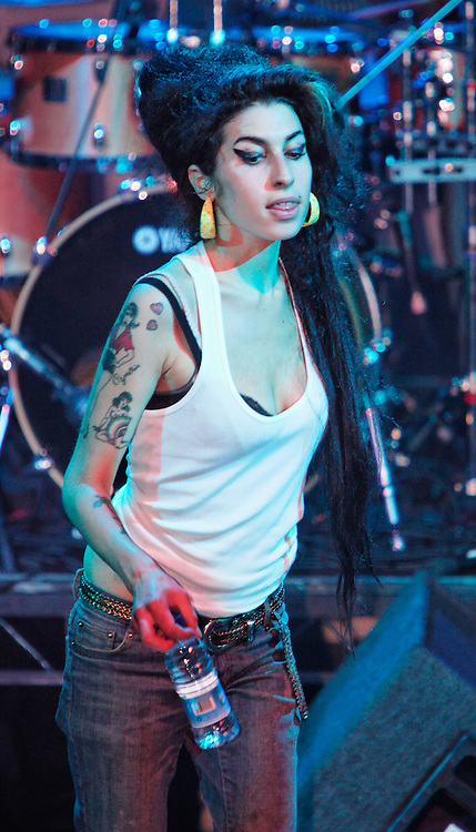 Singer Amy Winehouse, DOB=14/09/1983, performing for her gay fans at the G-A-Y Club. G-A-Y is London's biggest gay club and is held at the London Astoria nightclub, Soho, London, UK. Amy spent much of the show rubbing her itchy nose. She also seemed to have signs of old scars all down one arm...Picture Data:.Photographer: Edward Hirst.Copyright: ©2007 Licensed to Equinox News Pictures +448700 780000.Contact: Equinox Features.Date Taken: 20070415.Time Taken: 015621+0000.www.newspics.com