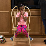 """Aliyah Randle listens as her housemates wish her well, January 22, 2016, during her going away party at the Child Crisis Center, Mesa, Arizona. Linda Ponter (right, education specialist) ask the children gathered, """"Is the center a forever home?"""" """"Nooooo,"""" they respond."""