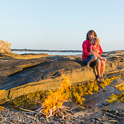 A woman and her young daughter enjoying a camp fire on East Gosling Island in Casco Bay, Harpswell, Maine.