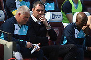 Swansea City Manager Paul Clement © looks on from his dugout seat. Premier league match, West Ham Utd v Swansea city at the London Stadium, Queen Elizabeth Olympic Park in London on Saturday 8th April 2017.<br /> pic by Steffan Bowen, Andrew Orchard sports photography.