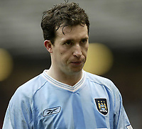 Photo. Aidan Ellis.<br /> Manchester United v Manchester City.<br /> FA Cup Fifth Round.<br /> 14/02/2004.<br />  City's dejected Robbie Fowler trudges of at the end of the game