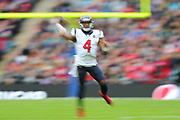 A slow shutter speed shot of Houston Texan's quarterback, Deshaun Watson (4) during the NFL game between Houston Texans and Jacksonville Jaguars at Wembley Stadium in London, United Kingdom. 03 November 2019