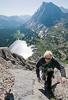 Joe Kelsey scrambles up the south shoulder of Pingora Peak during a recent trip into the Cirque of the Towers. Kelsey, who authored Climbing and Hiking in the Wind River Mountains, first visited the Cirque 40 years ago.