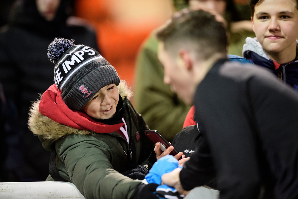Lincoln City's Conor Coventry gives away his NCS warm-up top to a fan<br /> <br /> Photographer Chris Vaughan/CameraSport<br /> <br /> The EFL Sky Bet League One - Lincoln City v Milton Keynes Dons - Tuesday 11th February 2020 - LNER Stadium - Lincoln<br /> <br /> World Copyright © 2020 CameraSport. All rights reserved. 43 Linden Ave. Countesthorpe. Leicester. England. LE8 5PG - Tel: +44 (0) 116 277 4147 - admin@camerasport.com - www.camerasport.com