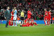 Liverpool players looking dejected after the penalty shoot out. Capital One Cup Final, Liverpool v Manchester City at Wembley stadium in London, England on Sunday 28th Feb 2016. pic by Chris Stading, Andrew Orchard sports photography.