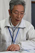 Portrait of Kazuo Anzai (62) works testing locally grown crops for radioactive contamination at the Becquerel Centre at a farmer's Market in Miharu, Fukushima, Japan, Wednesday May 1st 2013.