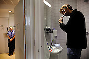 An inmate is brushing his teeth in the bathroom inside one of the single-person prison cells build with various amenities in the luxurious Halden Fengsel, (prison) near Oslo, Norway.