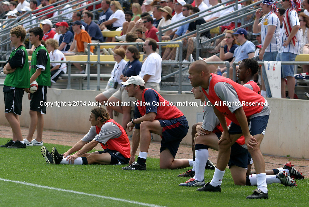 13 JUN 2004: U.S. reserves watch second half action. Earnie Stewart (standing, right) and from left on the ground or kneeling are Frankie Hejduk, Fitness coach Pierre Barrieu, Bobby Convey, and Cory Gibbs. The United States defeated Grenada 3-0 at Crew Stadium in Columbus, OH in the first leg of their second round World Cup Qualifying series. The series will conclude with the return game in Grenada a week later..