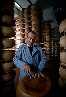 November 1989, Parma, Italy --- Checking the Quality of Parmesean Cheese --- Image by © Owen Franken/CORBIS