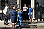 NHS Wales nurse Matthew Tovey c presents his NHSPay15 petition signed by over 800,000 people calling for a 15% pay rise for NHS workers at 10 Downing Street on 20th July 2021 in London, United Kingdom. At the time of presentation of the petition, the government was believed to be preparing to offer NHS workers a 3% pay rise in recognition of the unique impact of the pandemic on the NHS.