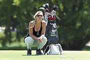 June 12 2013: Pollyanna Woodward, girlfriend of golfer Paul Casey, relaxes by his golf bag during the wednesday practice round at the 2013 U.S. Open hosted by Merion Golf Club in Ardmore, PA.