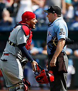 St. Louis Cardinals catcher Yadier Molina (4) argues with home plate umpire Adam Hamari (78) after he ejected relief pitcher Tyler Webb for hitting Kansas City Royals' Jorge Bonifacio with a pitch in the ninth inning of a baseball game at Kauffman Stadium in Kansas City, Mo., Sunday, Aug. 12, 2018. The Cardinals defeated the Royals 8-2. (AP Photo/Colin E. Braley)