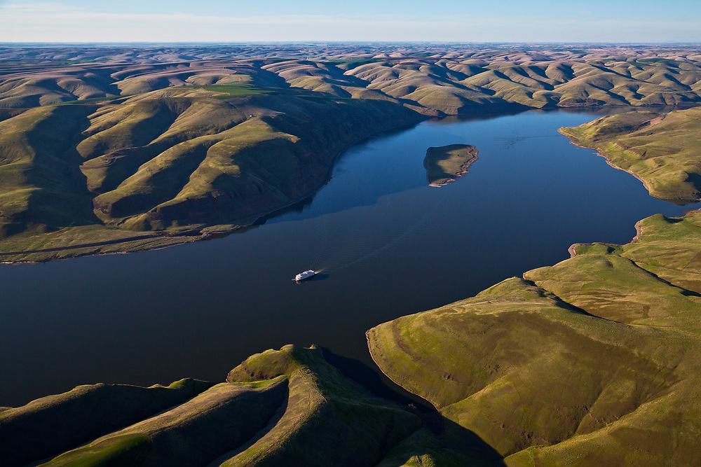 Aerial view of a luxurious River Boat tour vessel cruising up the Snake River between Clarkston, Washington on the Snake River and Hayden Island, Oregon on the Columbia River. Licensing - Open Edition Prints
