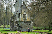 Tourists view ancient ruin of the house and dovecote of Minster Lovell Hall, a 15th century manor house in The Cotswolds, Oxfordshire, UK