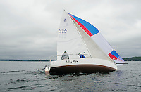 """Ed Philpot and Jack Donohue sail out of Saunders Bay with the """"Jolly Mon"""" crew during the JBT Race for the Cure on Saturday morning.  (Karen Bobotas/for the Laconia Daily Sun)"""