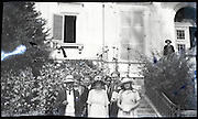 positive of damaged negative family posing outside a large house 1920s
