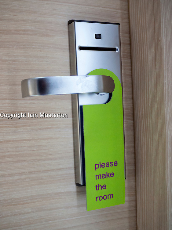 Sign on hotel room door asking for room to be cleaned