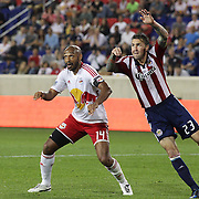 New York Red Bulls player Thierry Henry challenged by Danny Califf, Chivas, USA,  during the New York Red Bulls V Chivas USA Major League Soccer match at Red Bull Arena, Harrison, New Jersey, 23rd May 2012. Photo Tim Clayton