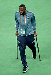 Chelsea's Antonio Rudiger walks on crutches during the training session at The Olympic Stadium, Baku.