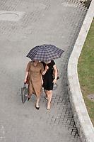 two women walk under umbrella in Shanghai China