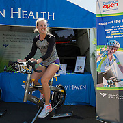 August 16, 2014, New Haven, CT:<br /> Alison Riske bikes on the Yale New Haven Health Spin Bike on day four of the 2014 Connecticut Open at the Yale University Tennis Center in New Haven, Connecticut Monday, August 18, 2014.<br /> (Photo by Billie Weiss/Connecticut Open)