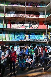 19 January 2015. New Orleans, Louisiana. <br /> Prospect 3, P3 New Orleans. <br /> Closing day for Exhibit BE draws huge crowds at the derelict De Gaulle Manor Community. A collaborative graffiti installation.<br /> ExhibitBE is the largest single-site street art exhibit in the American South.<br /> Photo; Charlie Varley/varleypix.com